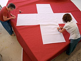 Makers of official Swiss flags could soon have to get their colour charts out to avoid heavy fines