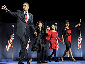President-elect Barack Obama takes the stage with his family during a victory rally in Chicago