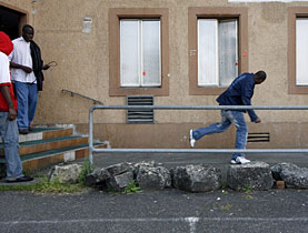 Amnesty International says asylum seekers have been victims of violence in Switzerland