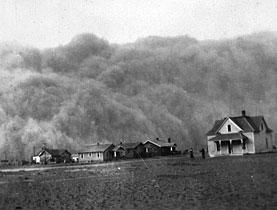 A cloud of dust engulfs houses in the United States in the 1930s