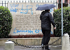 Swiss law punishes racist acts such as the defacing of this synagogue in Geneva last April