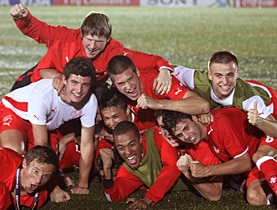 Swiss players celebrate after their 2-1 quarterfinal win over Italy