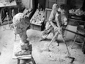Alberto Giacometti working on one of his famous walking man sculptures