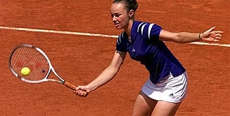 Top-seeded Martina Hingis of Switzerland volleys to Tathiana Garbin of Italy during their third round match at the French Open tennis tournament