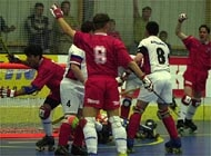 The Swiss players celebrate the second goal of Gilles Brentini (left)