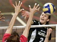 Switzerland's Lea Schwer smashes the ball towards the Hungarian side during the European Championships qualifyer