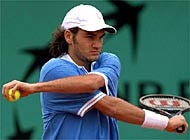Roger Federer at Roland Garros: the Swiss player is limbering up for a tough first match at Wimbledon