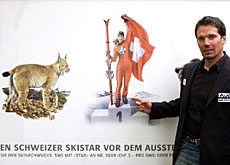 Swiss skier Bruno Kernen poses in front of the new advertising campaign