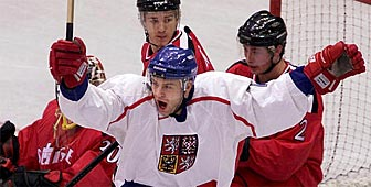 The Czech Republic's Zdenek Blatny (centre) celebrates his first period goal against the Swiss