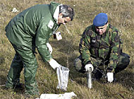Experts take soil samples to test for radioactive materials