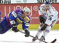 Zurich's Mattia Baldi (right) fights for the puck during the 4-1 win over Munich
