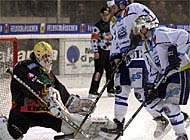 Rob Bonneau (centre) and Stephane Lebau of Ambri are blocked by Fribourg goalie Thomas Oestlund