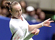Martina Hingis survived a scare from Ai Sugiyama to earn a semi-finals berth