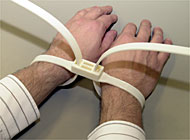 Plastic handcuffs are used to restrain unruly passengers (picture: SAirGroup)