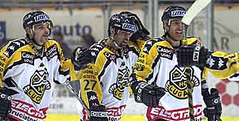 Aeschlimann (right) celebrates Lugano's opening goal but a long night was still ahead
