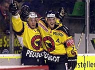 Juhlin (left) celebrates his second goal of the night with team-mate Rolf Ziegler