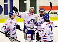 Kloten's players celebrate after scoring their fourth goal against the Lions