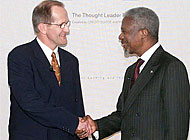 Kofi Annan (right), with the Swiss foreign minister, Joseph Deiss, addressed business leaders in Zurich