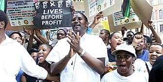 Demonstrators protest against the drug firms' case outside the high court in Pretoria