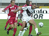 Lugano's Gimenez (right) comes under pressure from Sion's Ekobo (centre) and Hottiger (left)