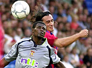 FC Basel's Hakan Yakin (right) fights for the ball from Aston Villa's Paul Baoteng in the Intertoto Cup final first leg
