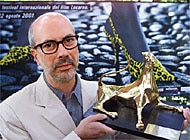 Italian director, Maurizio Sciarra, holds up his Golden Leopard award