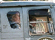 Former Argentinean President, Carlos Menem is flown to the High Court in Buenos Aries in a police helicopter