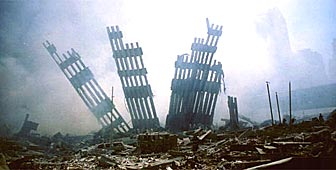 The remains of the World Trade Center stand amid the debris