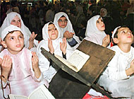 Muslim children in Switzerland attend prayer meetings like these children in Lebanon