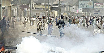 Police in Karachi fire tear gas to disperse protesters
