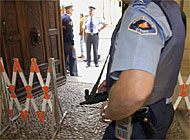 Security has been stepped up at public buildings in Switzerland in the wake of the Zug killings