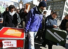 Ruth Dreifuss (right) helps carry the boxes containing signatures