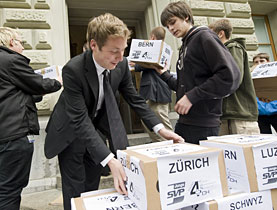 Campaigners carry boxes with signatures to the Federal Chancellery