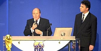 Blatter (left) with his rival Zen-Ruffinen during the draw for the 2002 World Cup