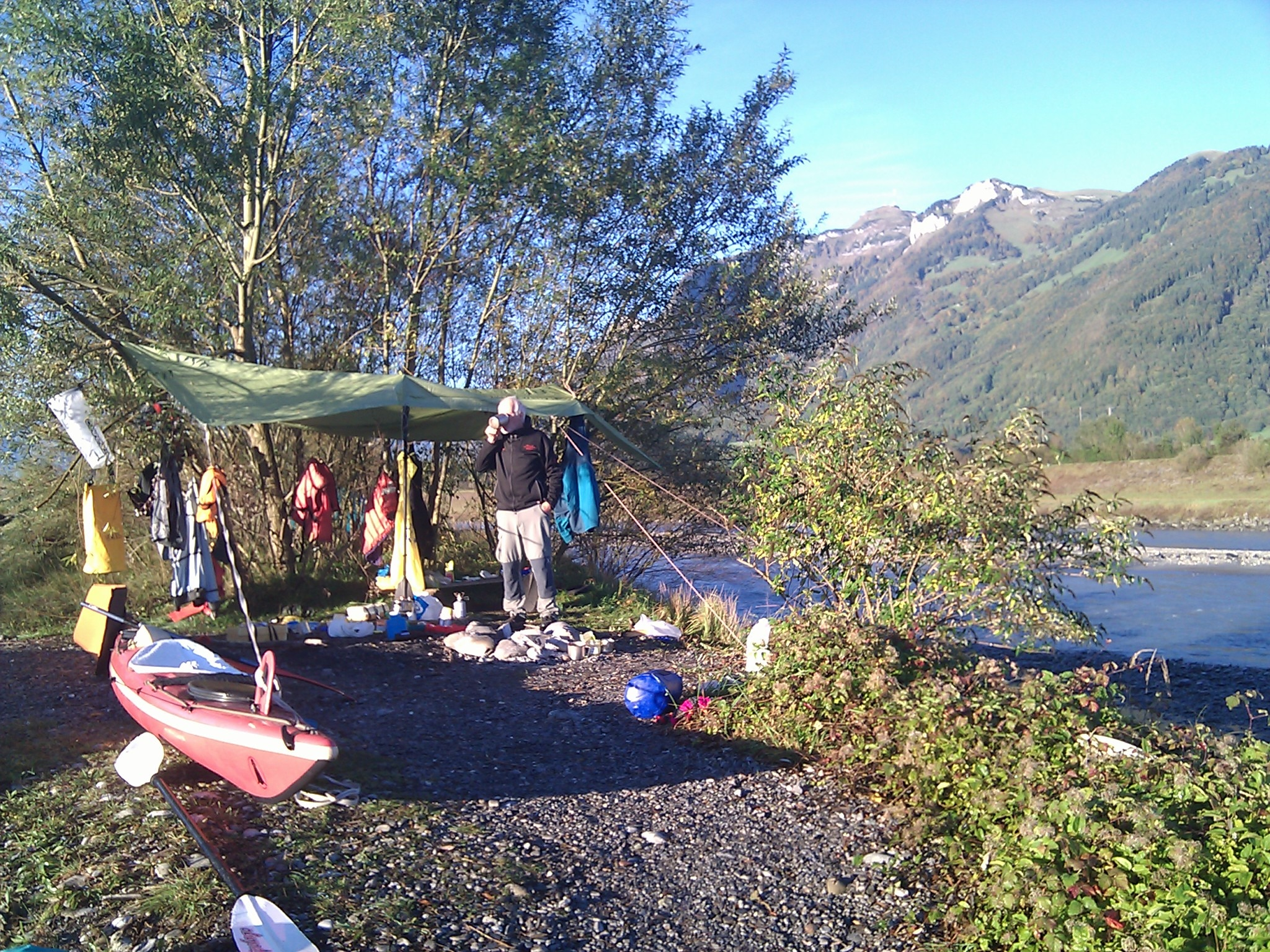 Overnight the clouds departed and the rivers dropped a full meter. Here we are breaking camp.