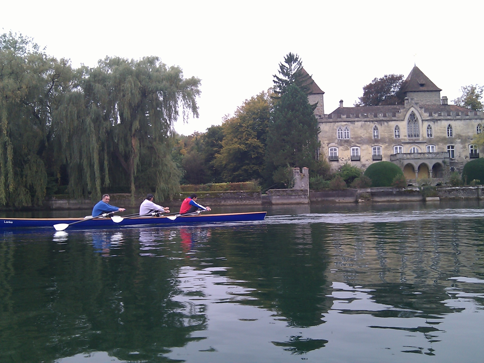 Rowers powering past a castle near Kreuzlingen.