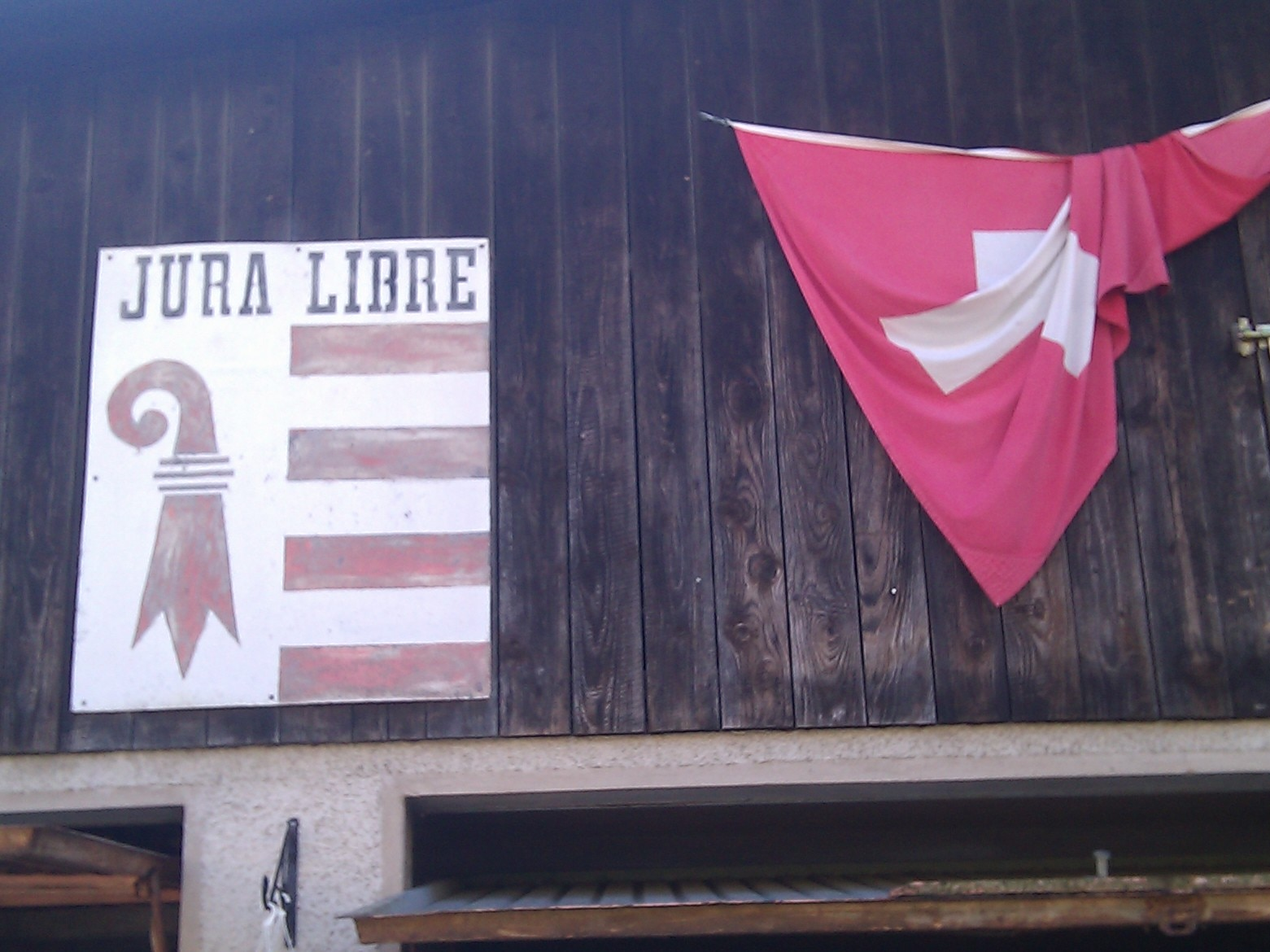 The Jura Libre banner likely dates from the late 1960s when the region fought (mostly non-violently) to split from Bern.