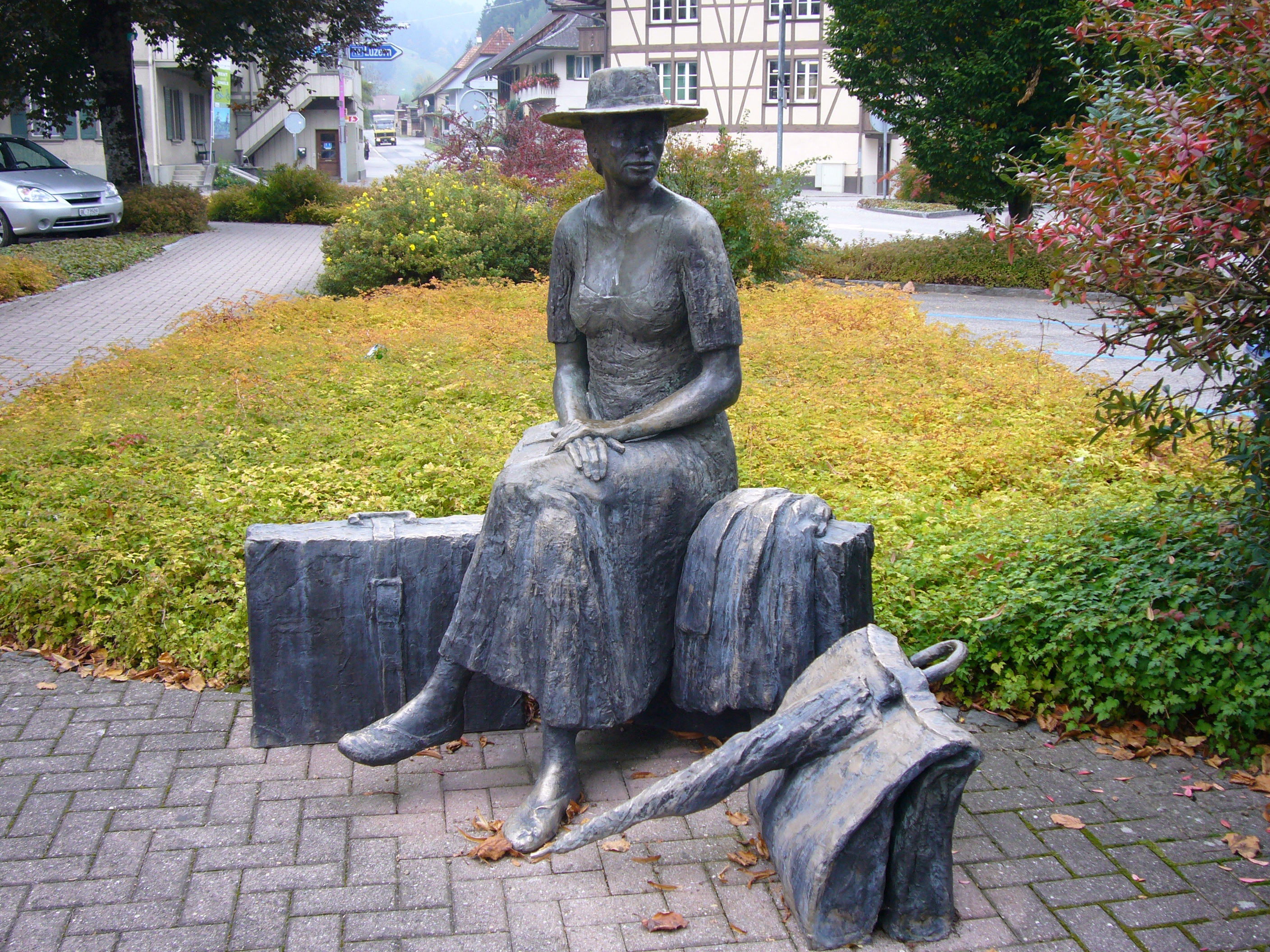 "The people of Trubschachen love their art. This is ""The Traveller"", a work by Robert Indermaur, who used his wife Barbara as his model for the figure. She sits near the railway station (Robert Brookes)"