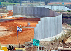 Israel's wall in the West Bank is a concrete symbol of the divisions