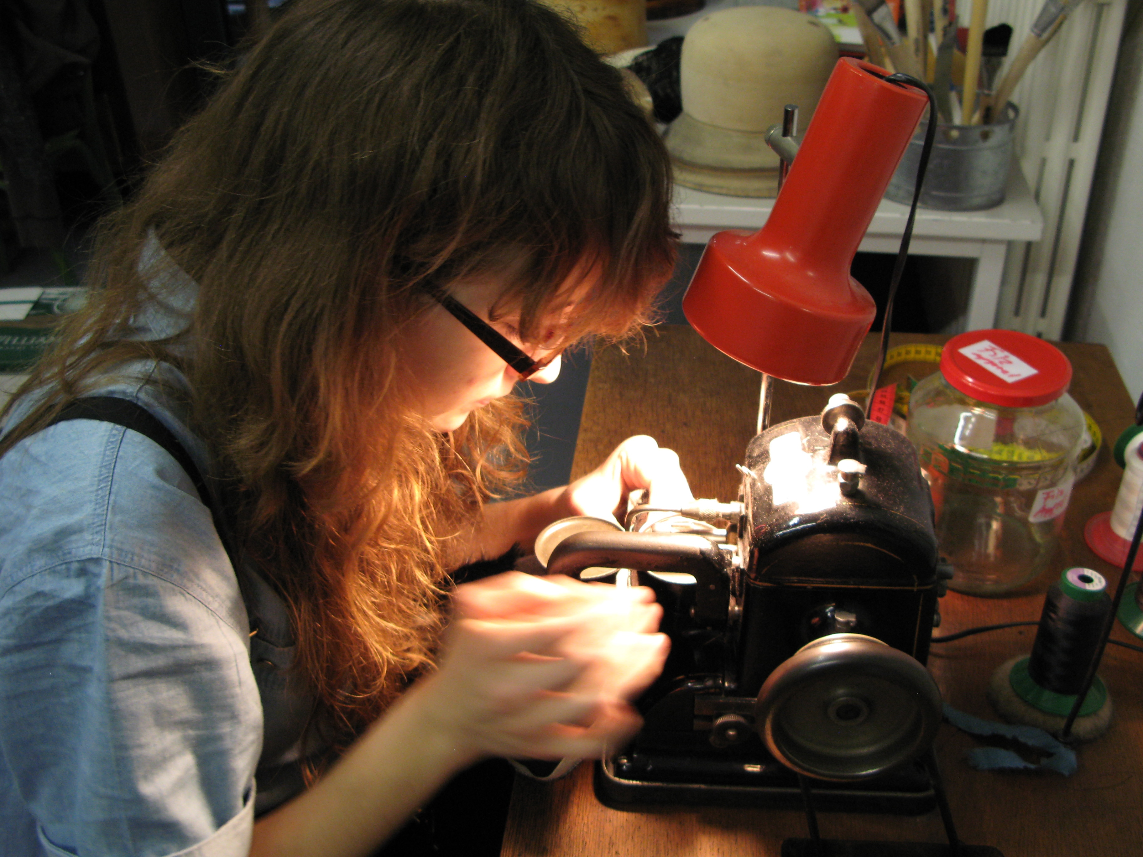 Apprentice Jasmin Rigert uses a special machine to sew a rabbit fur hat.