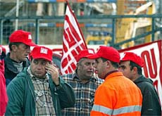 Striking construction workers at a building site near Lucerne