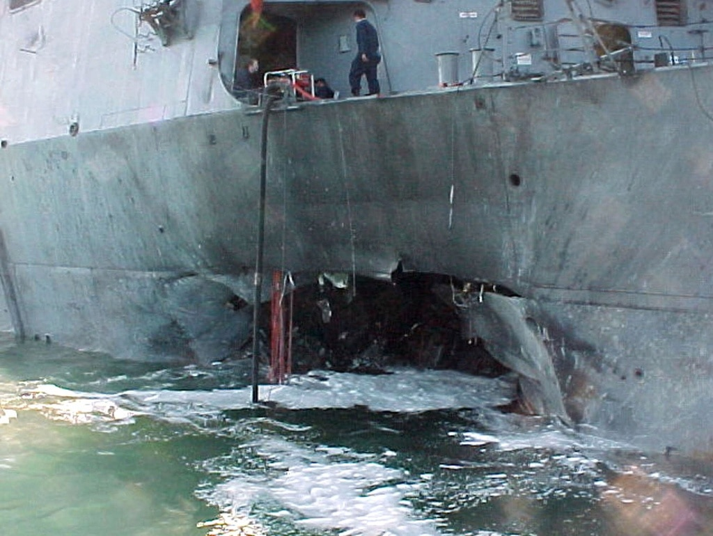 October 12, 2000. Bombing of US warship Cole in Aden harbour kills 17 sailors and blows hole in navy vessel's hull. (Keystone/AP Photo/US Navy)