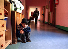 Children of asylum seekers play in the corridors of a reception centre