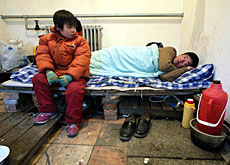 An Aids-infected father in a Chinese hospital awaits treatment