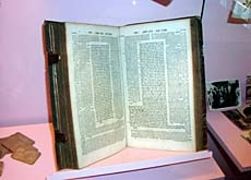 Exhibits include a 1750 edition of the Talmud