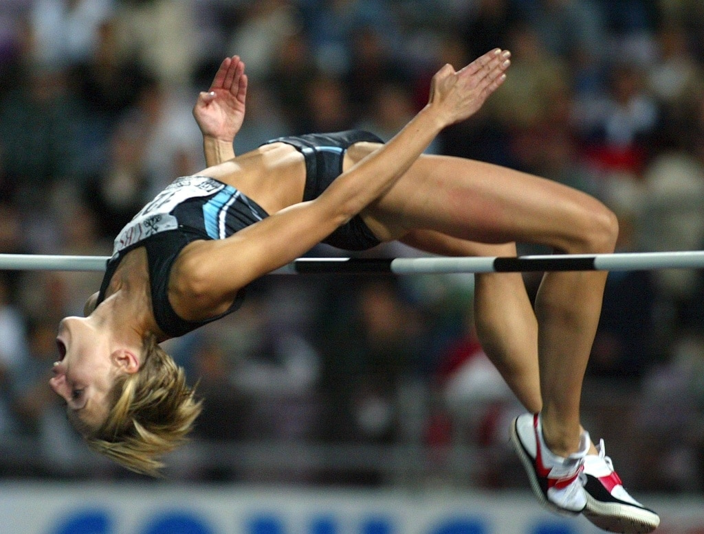 Sweden's Kajsa Bergqvist crosses the bar of the high jump at the Athletissima meeting in 2002.  (Keystone/Fabrice Coffrini)