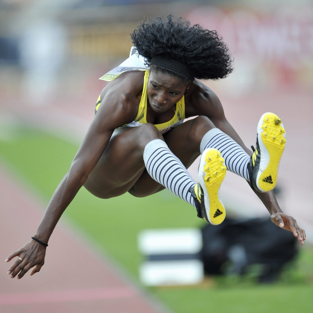 Yargelis Savigne of Cuba jumps during the women's triple jump at the Athletissima meeting in 2009.  (Keystone/Dominique Favre)
