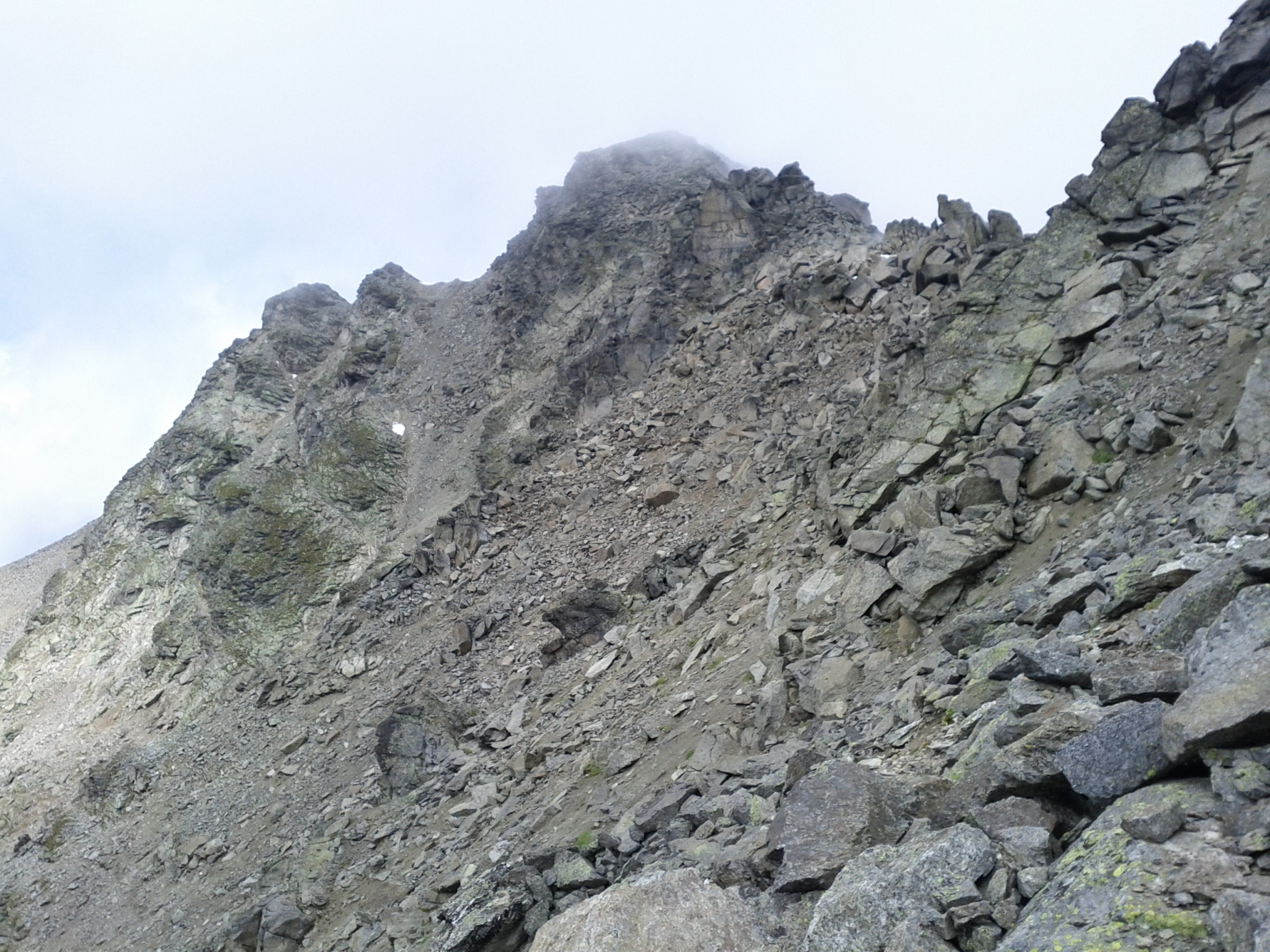 The summit of Sesvenna briefly revealed itself during my descent.