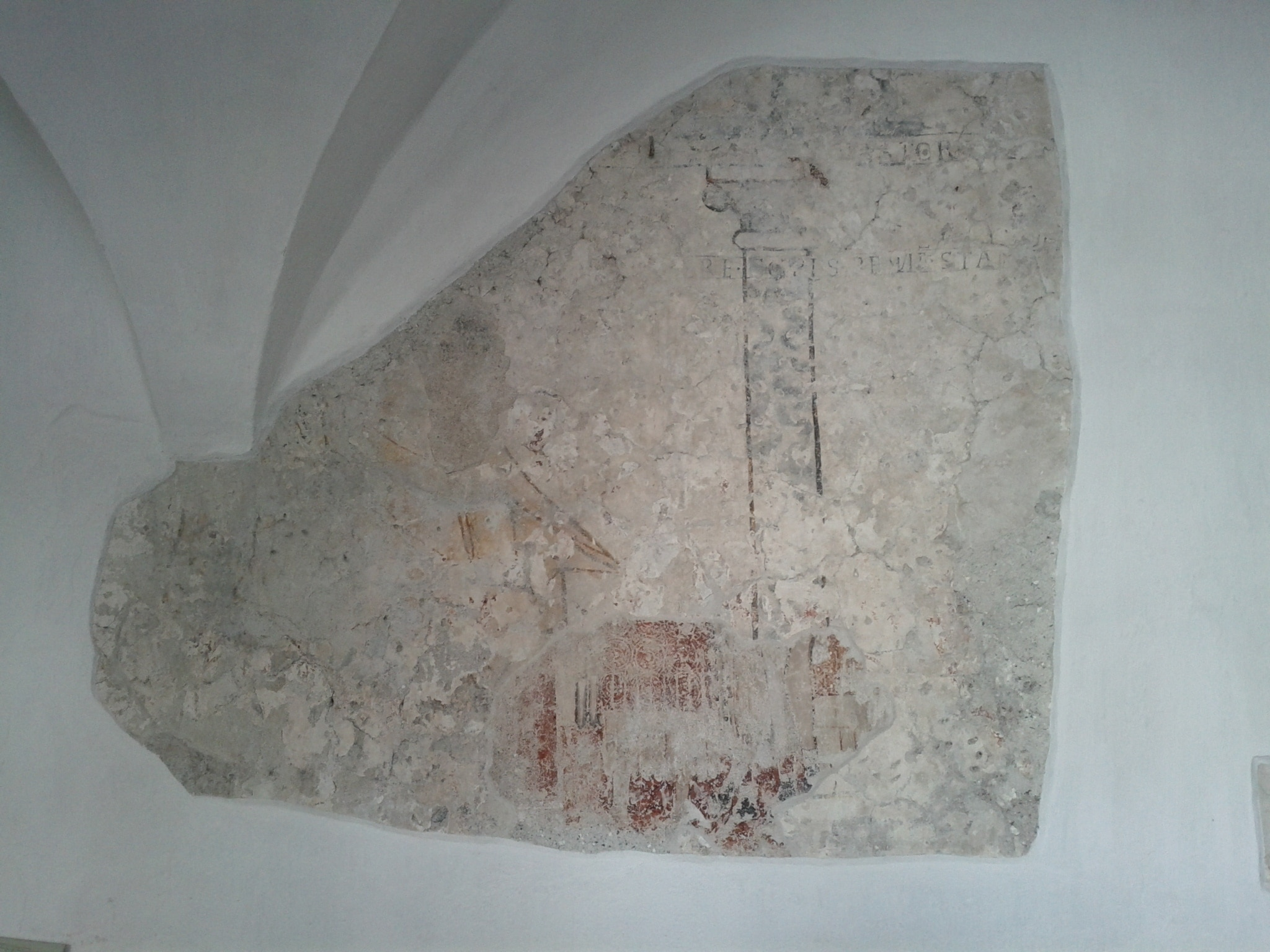 Some of the original eighth-century fresco work exposed under many following layers of stucco