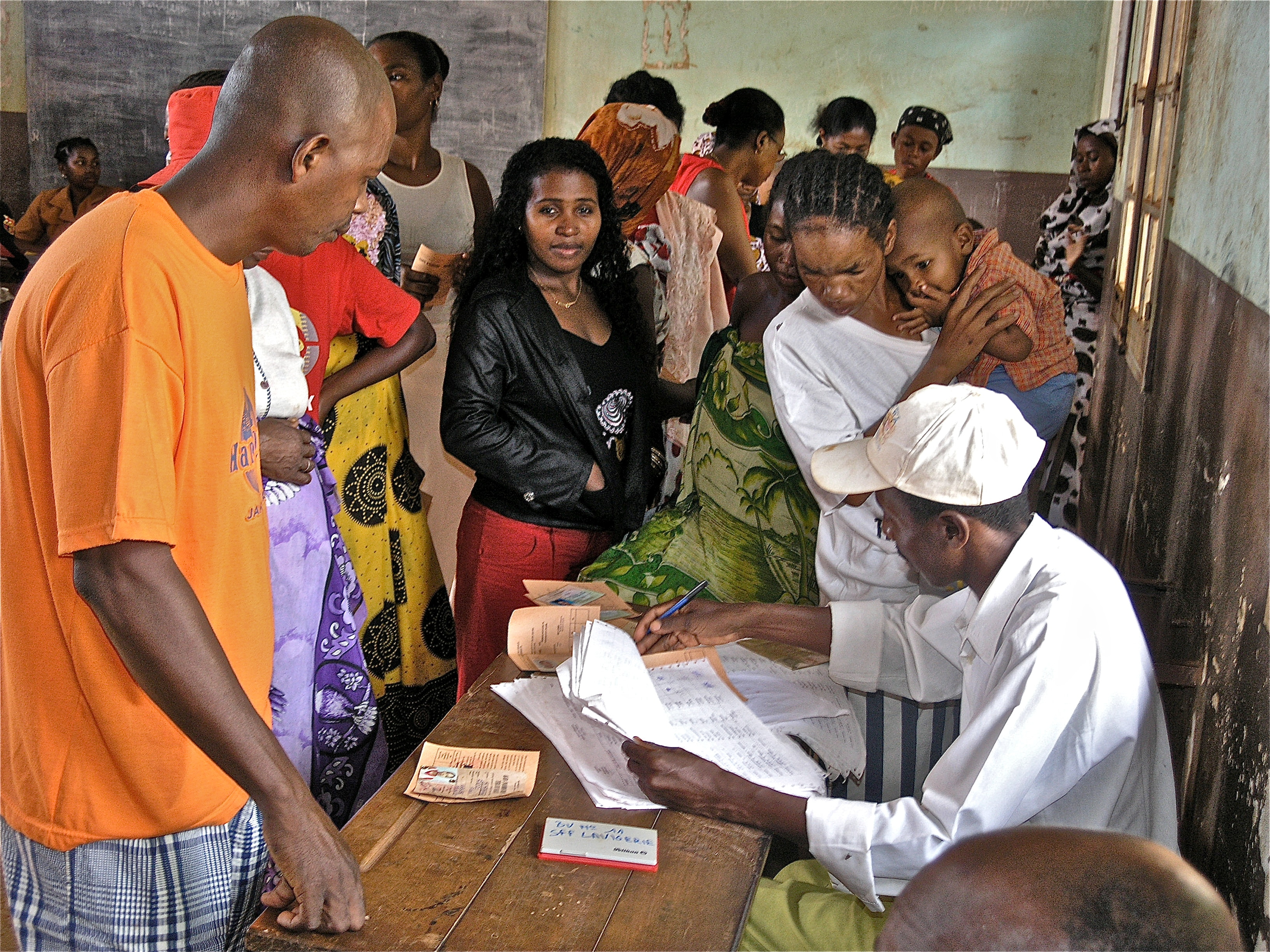 Officials check the electoral roll to see whether a voter is entitled to participate in the 2006 presidential elections in Madagascar.